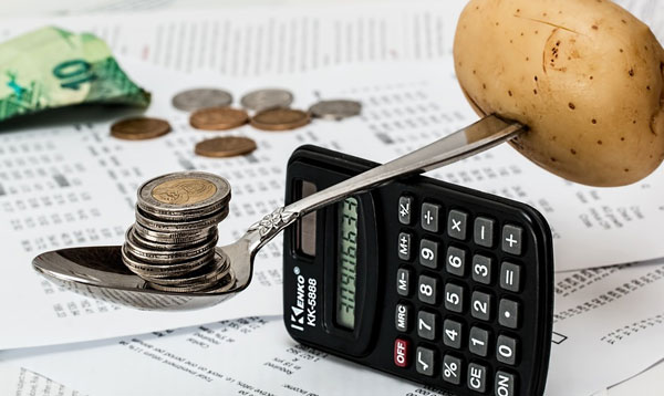 Calculator and coins on the table