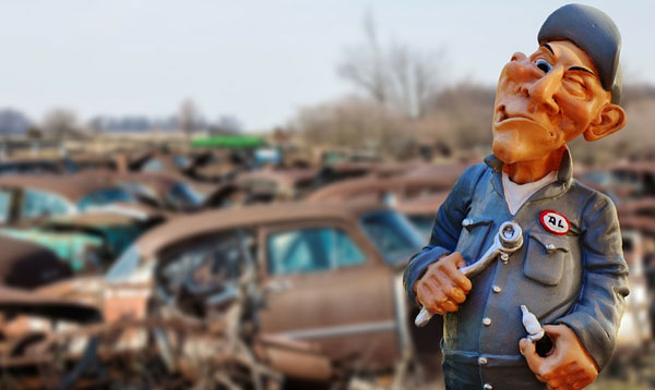 Man on junkyard