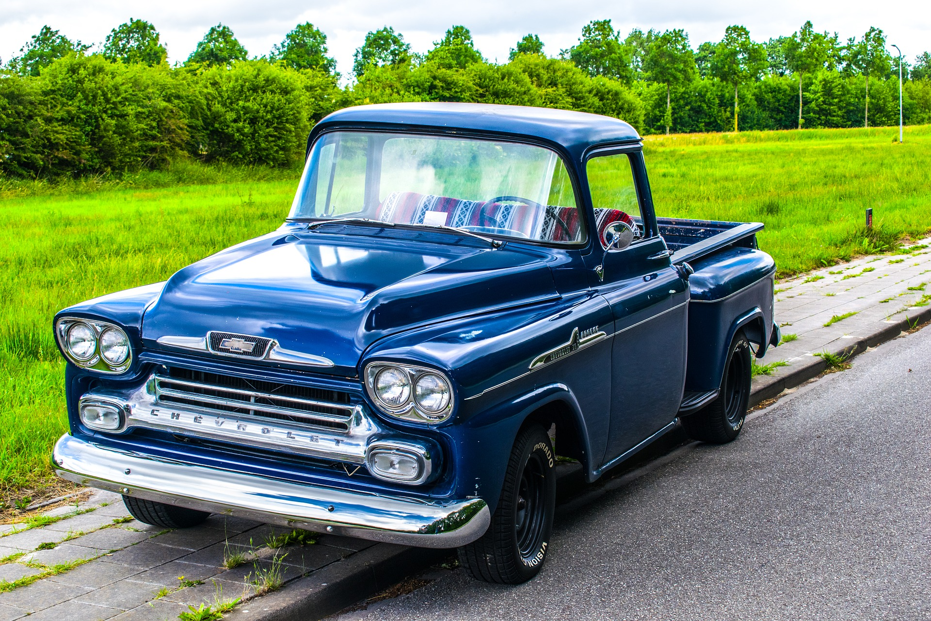 blue chevrolet park on a road side